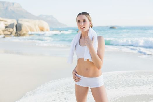 Thoughtful slender woman holding white towel