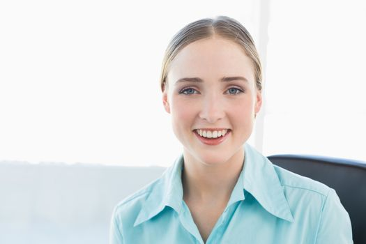 Classy smiling businesswoman looking at camera