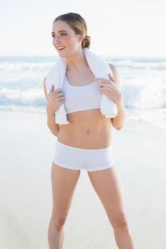 Happy slender woman holding white towel