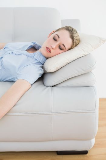 Young classy businesswoman sleeping on her couch