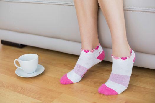 Young slender woman wearing pink socks