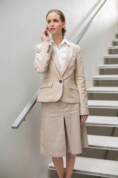 Stern stylish businesswoman phoning