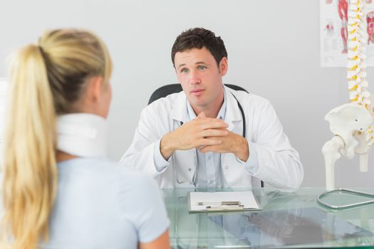 Concerned doctor having an appointment with a patient
