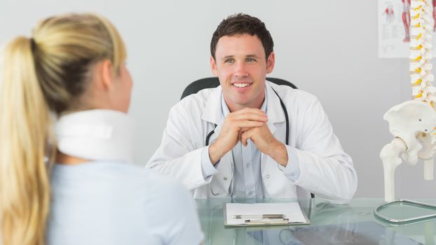 Smiling doctor having an appointment with a patient