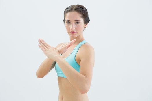 Portrait of a fit woman standing in defending position