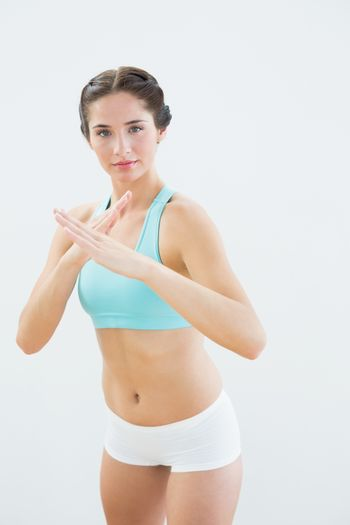 Portrait of a fit young woman in defending posture