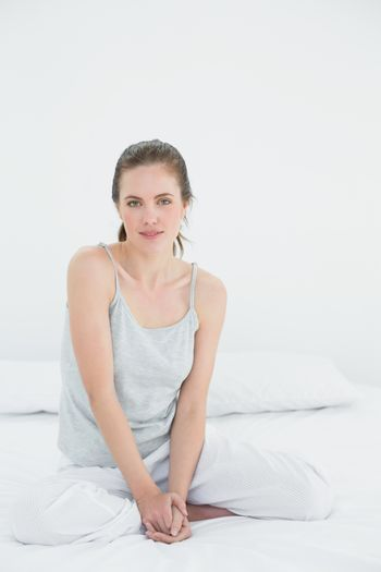 Portrait of a woman sitting in bed