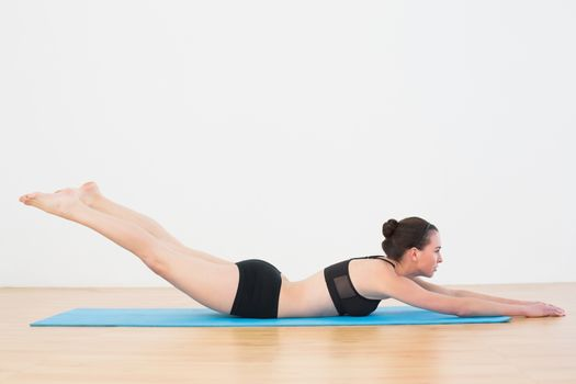 Sporty young woman doing the Locust Posture