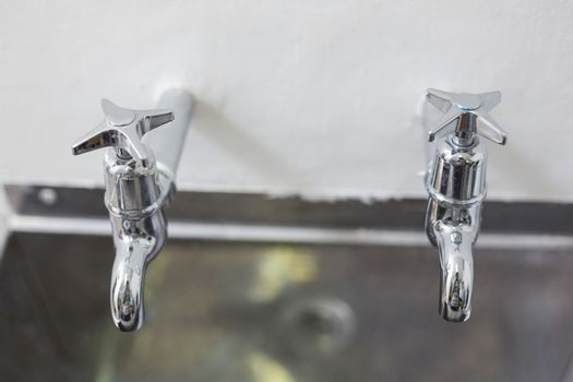 Two taps and stainless steel kitchen sink