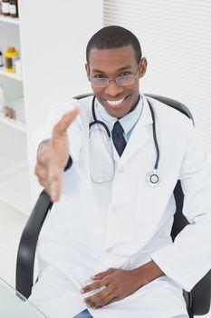 Doctor offering a handshake at medical office