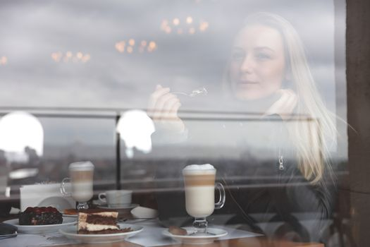 Dreamy woman in cafe
