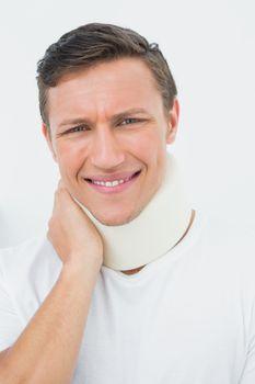 Closeup of a young man wearing cervical collar