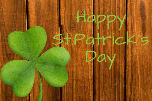 Happy st patricks day on wooden background