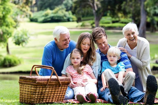 Multi-generation family having a picnic in the park