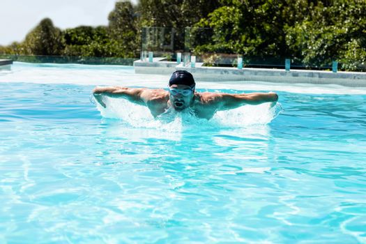 Fit swimmer doing the butterfly stroke