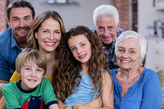 Portrait of smiling multi-generation family at home