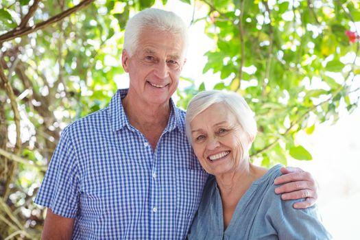 Smiling senior couple with arm around