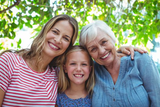 Portrait of happy family with granny standing outdoors