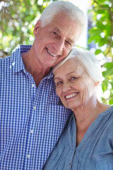 Satisfied senior couple with arm around