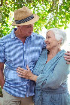 Senior couple with arm around while talking