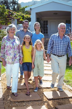 Happy multi-generation family walking on footpath