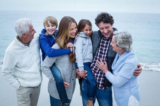 Cheerful multi-generation family enjoying at sea shore