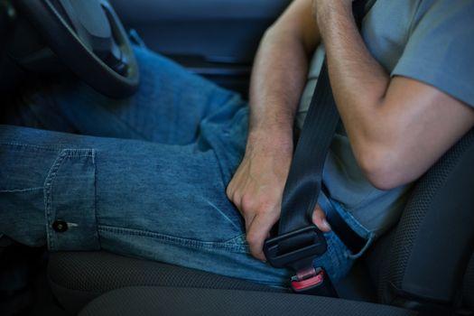 Driver fastening car seat belt