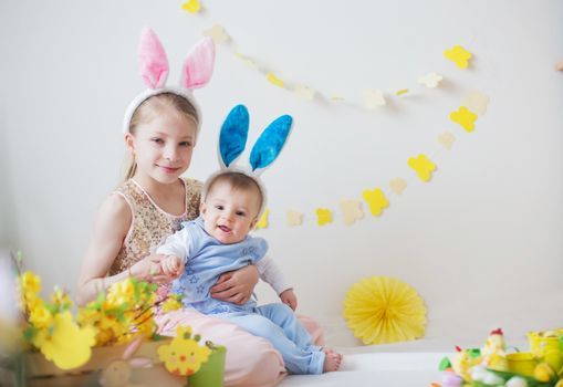 Cute little children boy and girl wearing bunny ears in Easter