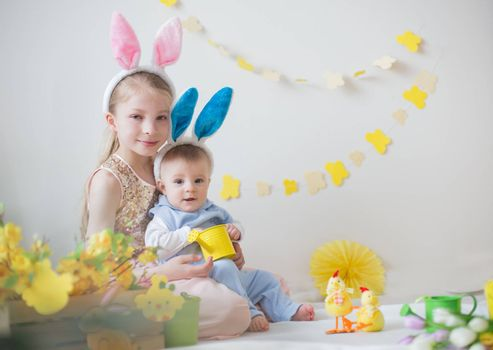 Cute little children boy and girl wearing bunny ears in Easter decor