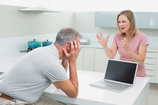 Couple having an argument in kitchen