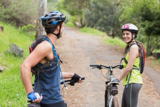 Happy couple with bikers on footpath