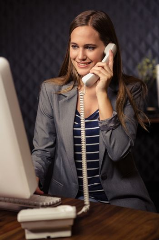 Creative businesswoman land line