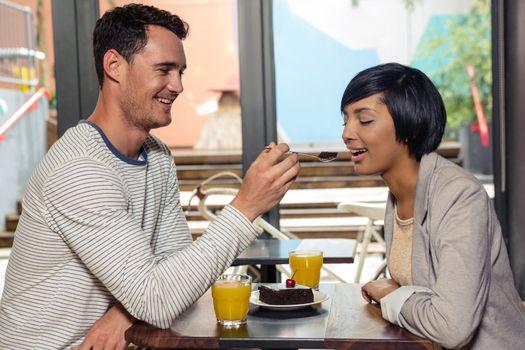 Boyfriend feeding his girlfriend