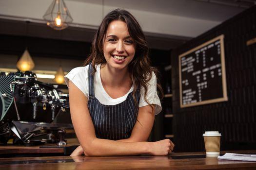 Portrait of smiling barista