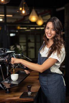 Barista preparing coffee with machine