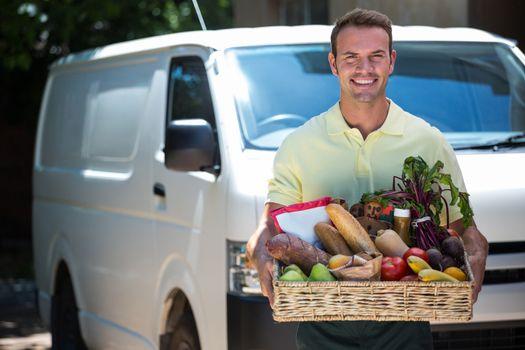 Happy man delivering groceries