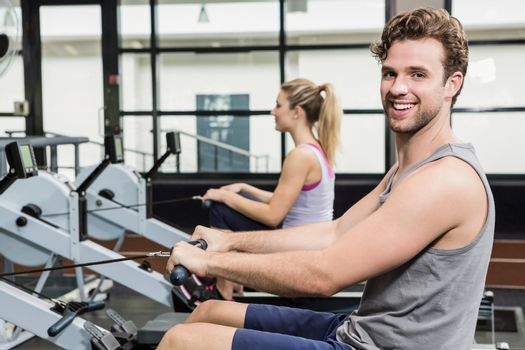 Portrait of man working out on rowing machine