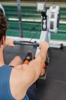 Man exercising on rowing machine