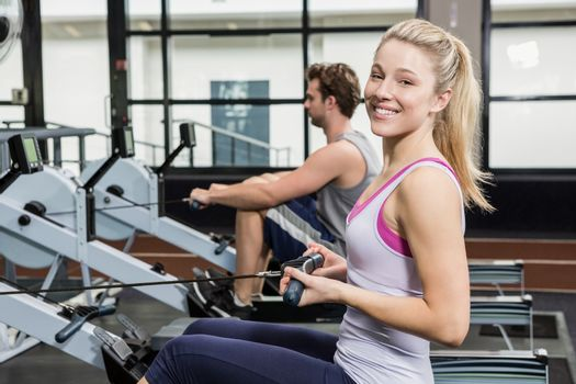 Portrait of woman working out on rowing machine