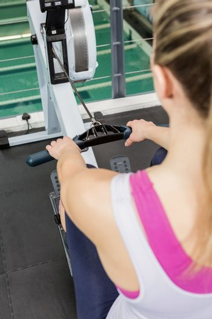 Woman exercising on rowing machine