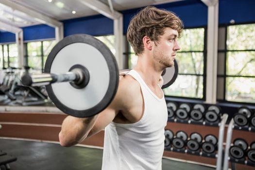 Man lifting a heavy barbell