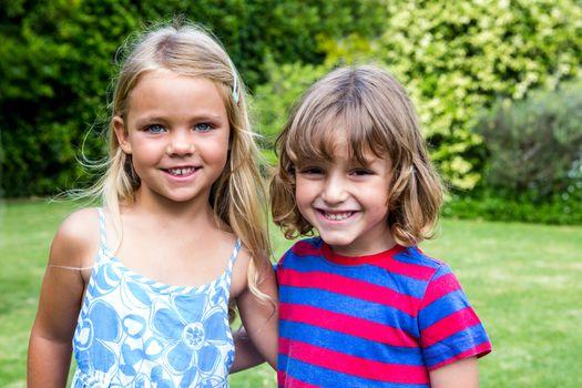 Portrait of siblings in back yard