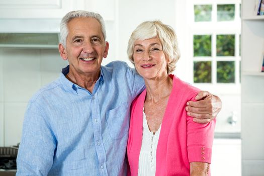 Retired couple with arm around