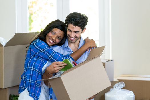 Young couple embracing at home