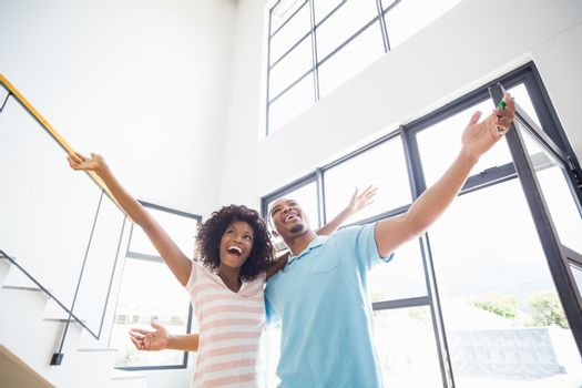 Excited young couple in their new home