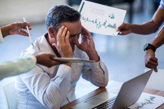 Businessman frustrated at his desk
