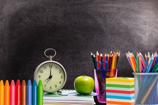 Composite image of education items on black background