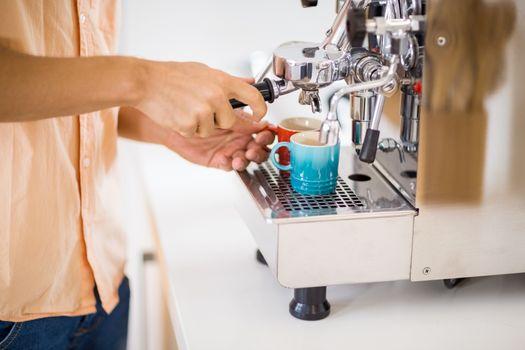 Man preparing coffee from coffeemaker