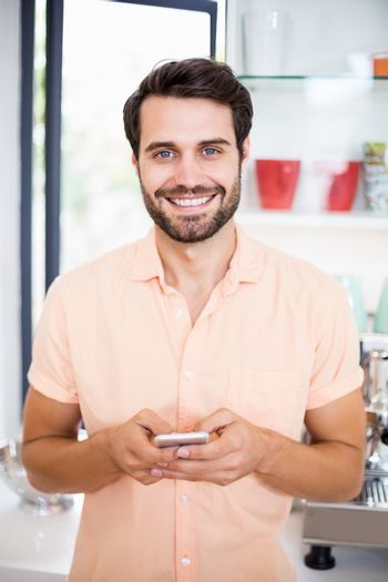 Man text messaging on mobile
