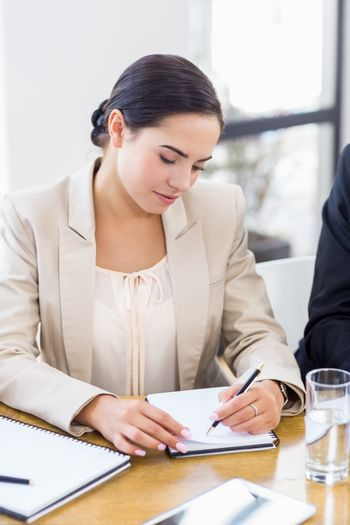 A businesswoman is concentrating and looking at her notes